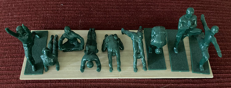 Group of Yoga Joes doing postures