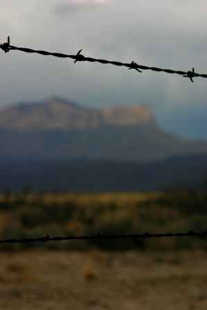 Guadalupe Mountains behind barbed wire