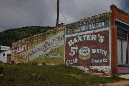painted advertisement brick wall victor colorado