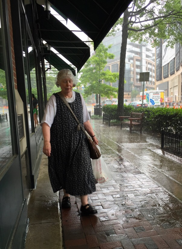 woman with rain hood during a rain storm in bethesda, maryland