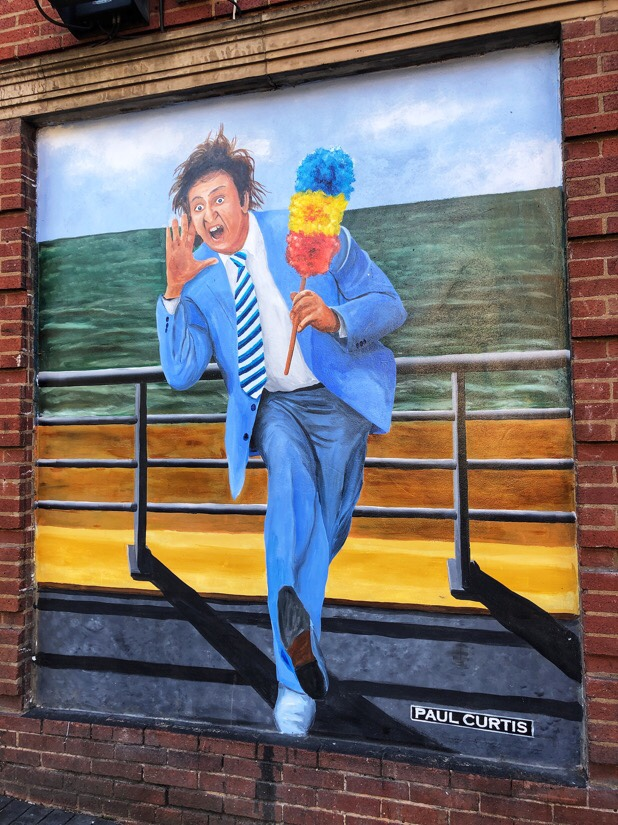 Ken Dodd painted by Paul Curtis on the wall of the Liverpool Royal Court Threatre