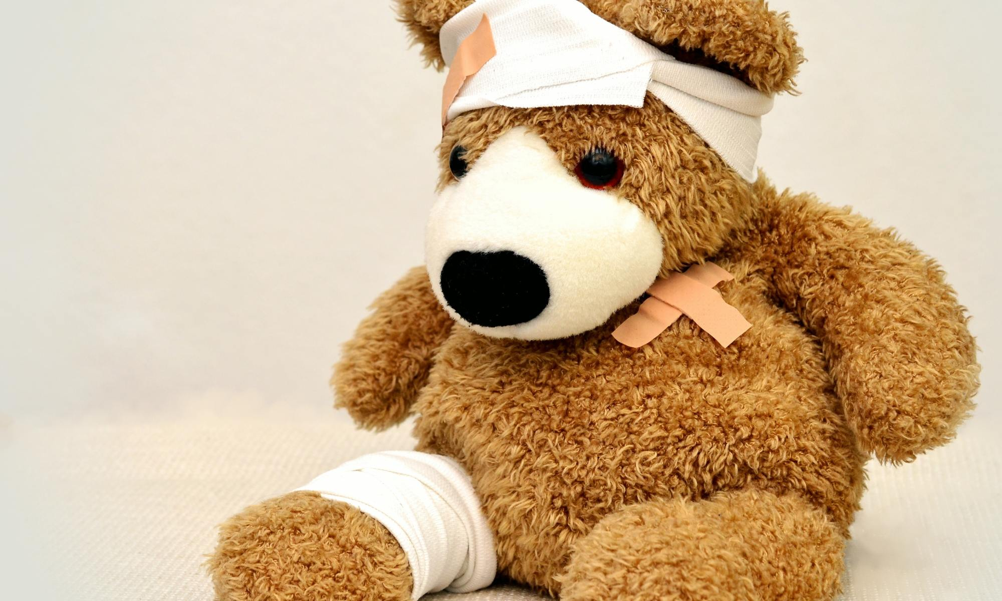 A stuffed bear toy with bandages