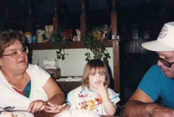 Photo: Rachel's grandmother, left, Rachel as a little girl eating cake with her fingers, center, and her uncle Kenny, right