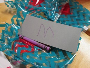 Little brother packaged up a (used) crayon and a scrap of paper with his initial on it.