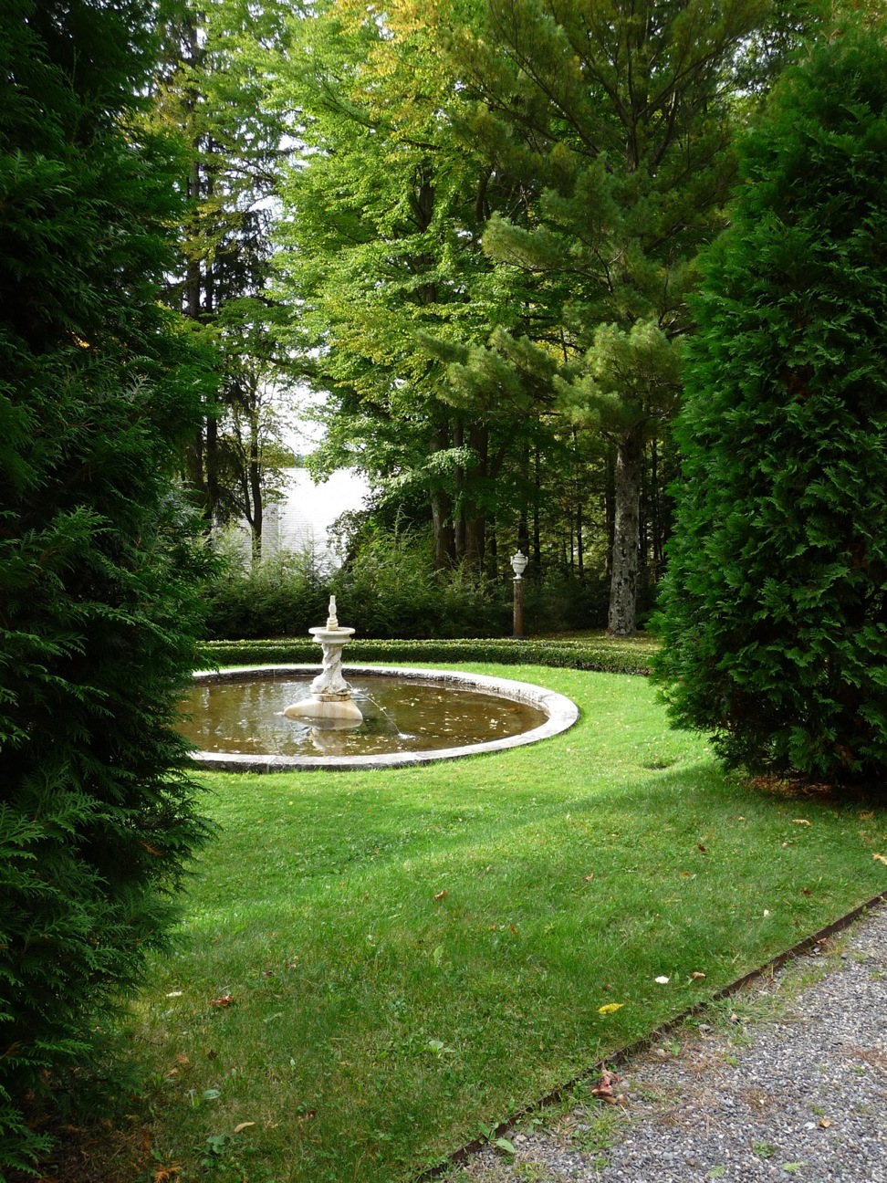 The lawn slope between the Arborvitae Walk and the fountain is short enough and just shallow enough still to be mowable.