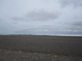 An empty, rocky landscape under a gray sky.