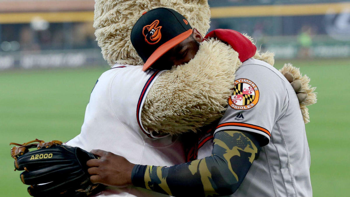 Baseball player hugging mascot