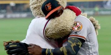 Baseball player hugging mascot