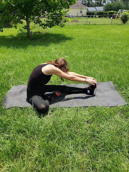 Lower Body yoga poses for runners - seated one leg forward fold