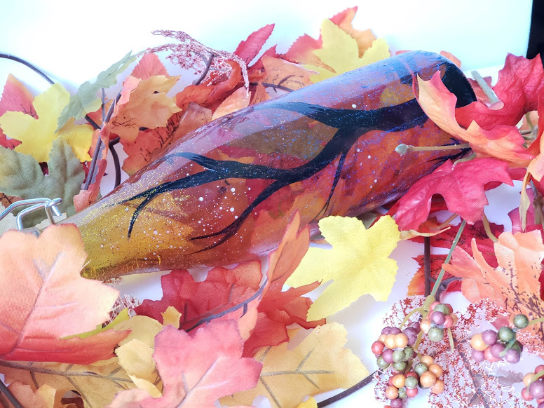 fall dollar store craft, putting autumn in a bottle step 3, add your colored water and fake leaves