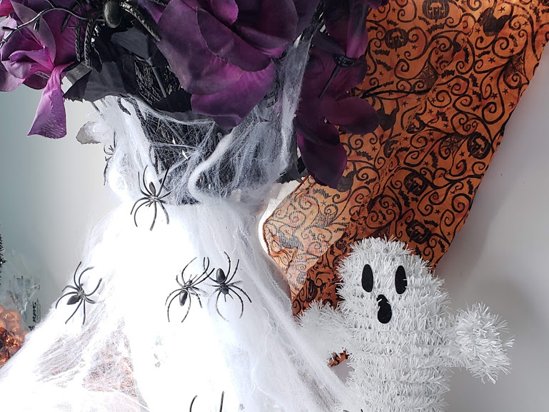 dollar store halloween vase with webbing in flowers