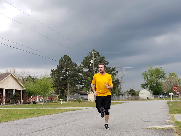 Speedworkouts for runners, a man doing a speed workout on a neighborhood road.