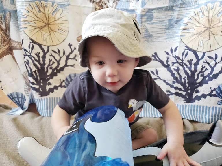 Becoming a grandma, grandson playing with pool toys
