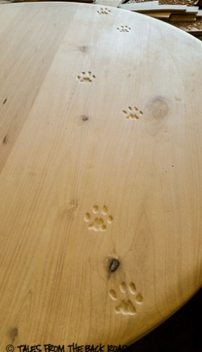 Custom table and chairs carved bobcat tracks