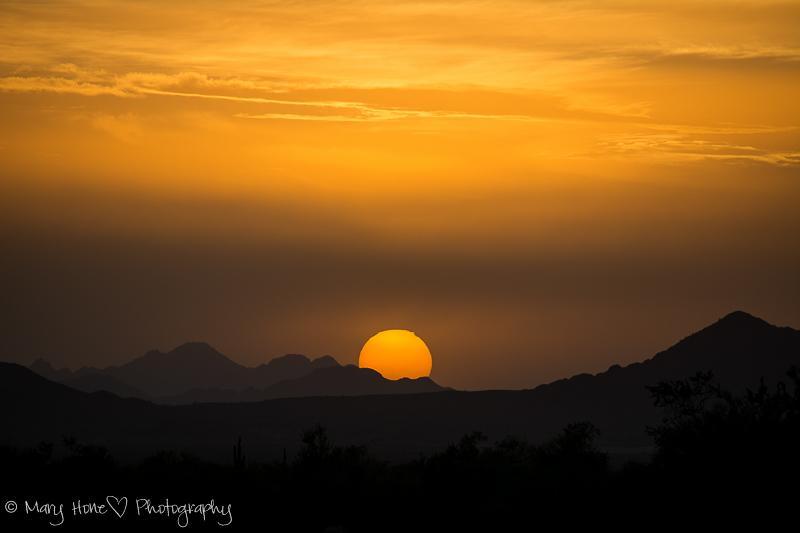 Sunset sun sinking into the desert