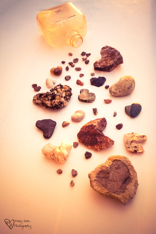 heart rocks and an old bottle