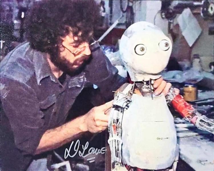 Photo of animatronic Yoda signed by Dennis Lowe TTM