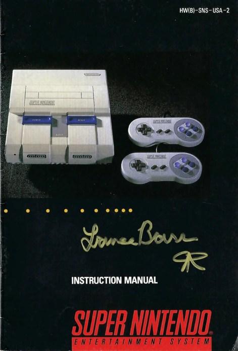 SNES instruction manual signed by the illustrator/designer Lance Barr.