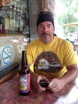 Reward after the day's ride: a cold beer and a slice of pizza at Poker Alice.