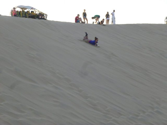 One of the 'victims' sandboarding in Huacachina