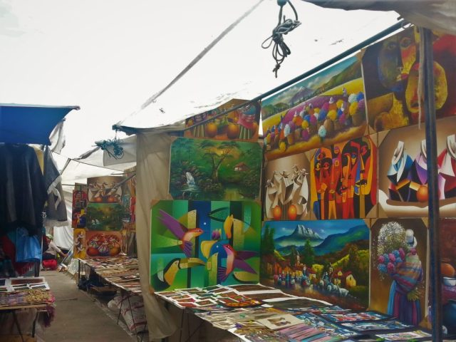 Colourful paintings for sale in the market in Otavalo Market