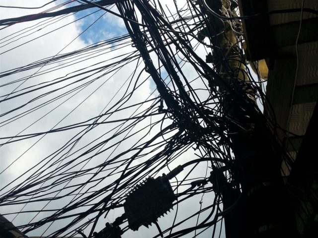 Bundles of wires show the dangers of slum living in the Rio Favelas