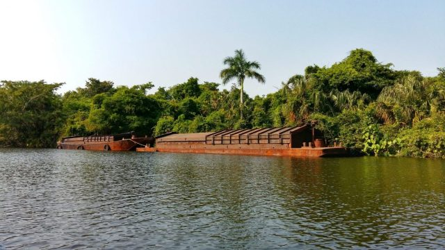 These Rusting Barges Transport the Molasses from the Sugar Factory