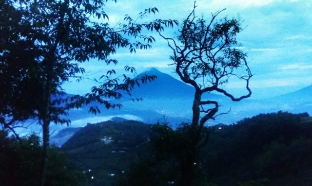 As daylight fades, catch a glimpse of the gorgeous view from Hobbitenango Antigua
