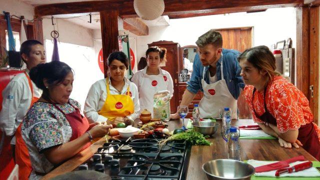 My classmates listening intently to Guatemalan cook Sonia - Guatemalan food cooking class antigua guatemala