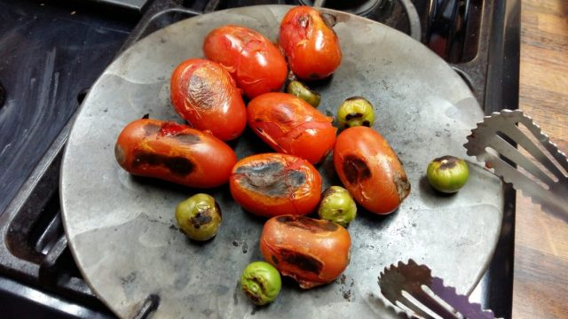 I was grilling tomatoes for our Pepian - a classic Guatemalan recipe - cooking guatemalan food