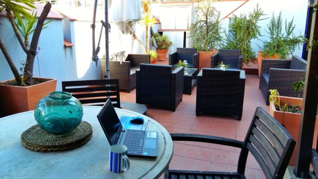 Laptop for working on the downstairs terrace at NORN Barcelona