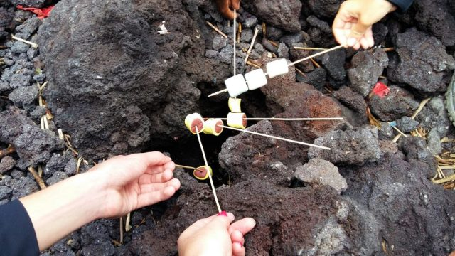 Toasting Marshmallows on the hot lava on Pacaya Volcano near Antigua Guatemala