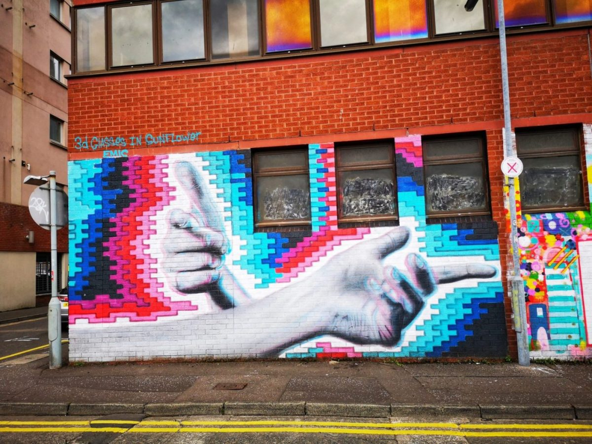 Street Art in Belfast - a 3D Mural pointing two ways