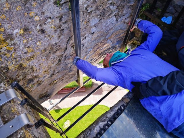 Me Attempting to Kiss the Blarney Stone at Blarney Castle