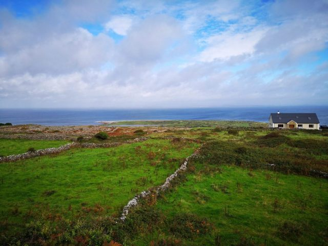 Stone Walls and a Beautiful Sea View on Inishmore - Visiting the Aran Islands from Galway