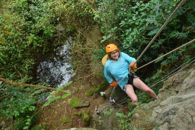 Rappelling down into a sinkhole in a Maya village