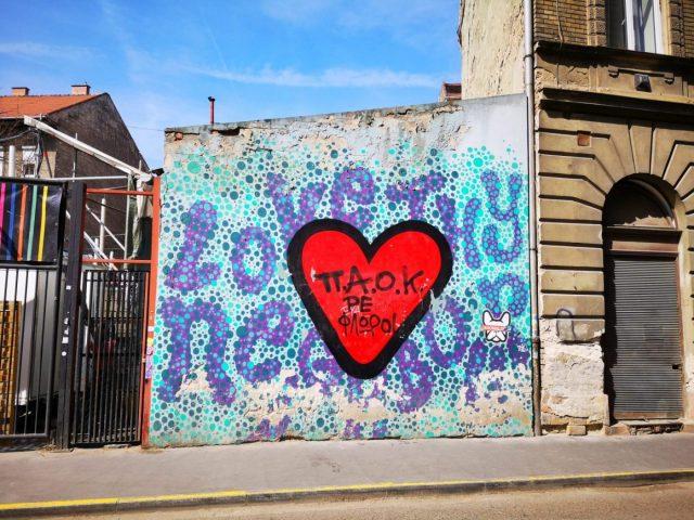 Love Thy Neighbour street art in Budapest