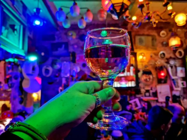 A trippy glass of rose wine in Szimpla Ruin Bar