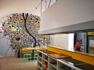 The hostel kitchen with a mural of Budapest