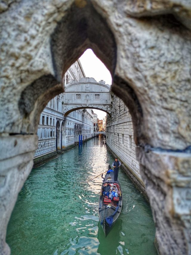 A Gondola passing by the Bridge of Sighs