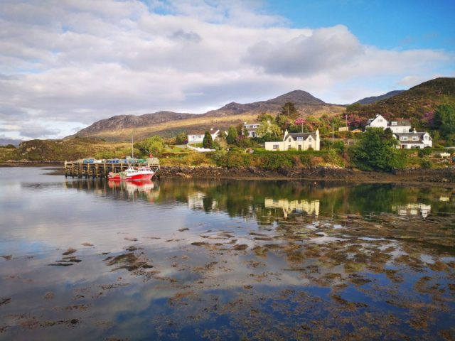 Kyleakin on the Isle of Skye - White ouses reflected in the still water of the bay with hills in the background