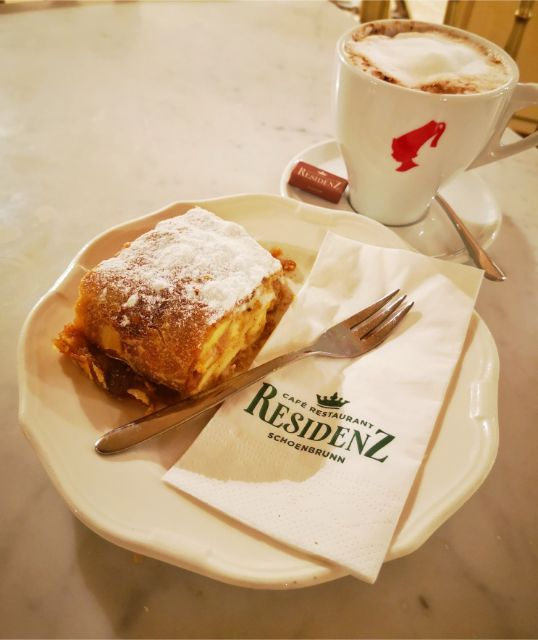 A large portion of apple strudel and hot chocolate at the Strudel Show in Vienna