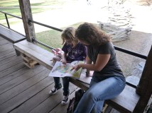 Reading over her Junior Ranger book