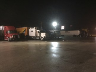 Our first night on the road. We look so small next to those semis!