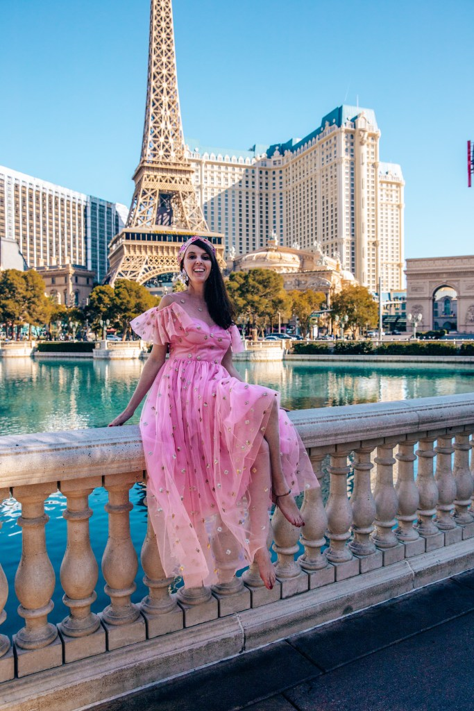Eiffel Tower Las Vegas with woman in a pink dress