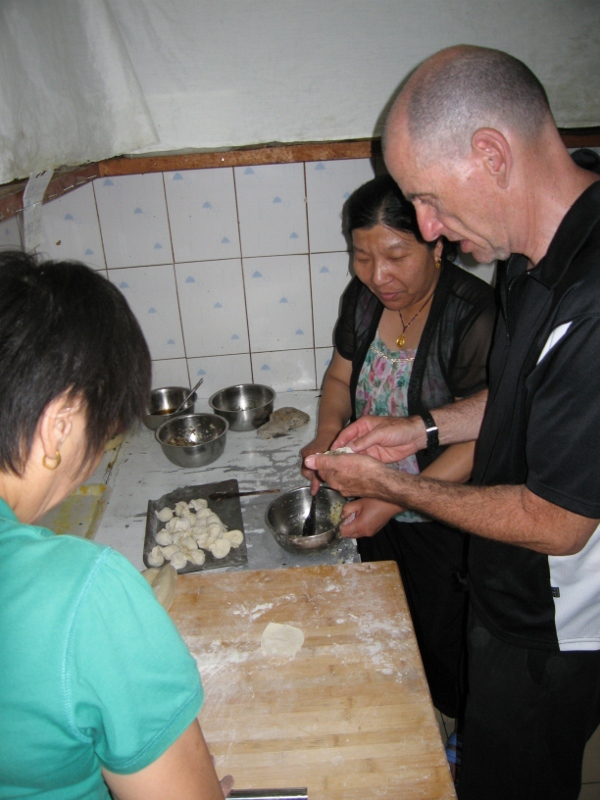 Jules help make dumplings at a restaurant