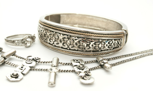 Silver ancient style bracelet,ring,necklace isolated on white background.
