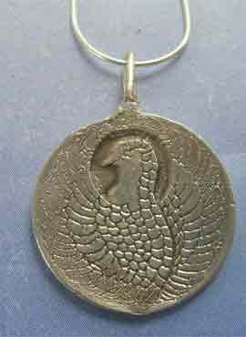 colgante ave fenix y dragón amuleto chino de plata