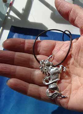unicornio colgante de plata