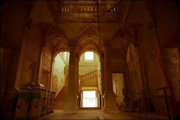 Urbex exploration of an abandoned castle in Hungary. Grand hall under renovation.